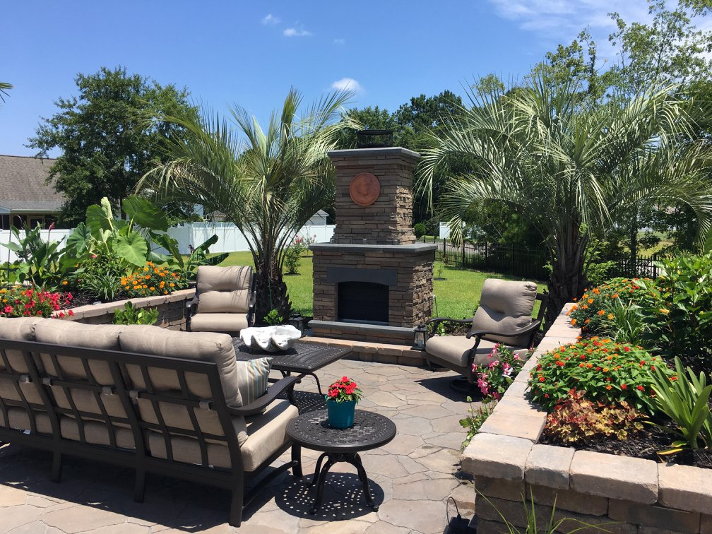 Outdoor Fireplace & Living Spaces Installed by Myrtle Beach Landscaping Company